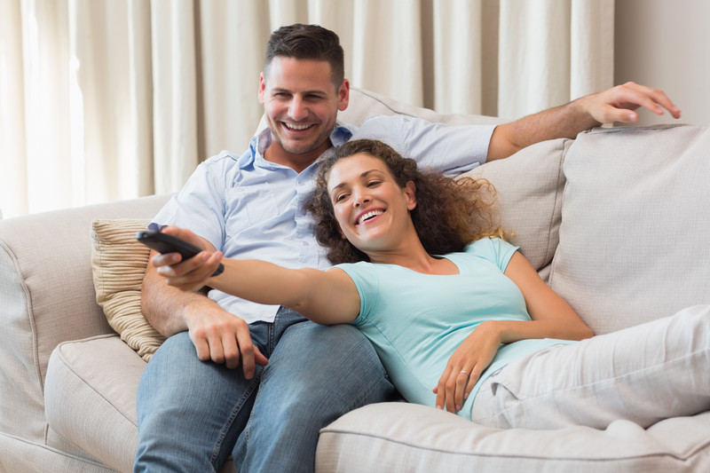 Couple relaxing in couch at home